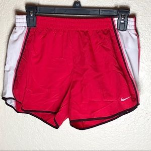 NIKE DRI FIT pink lined athletic running shorts